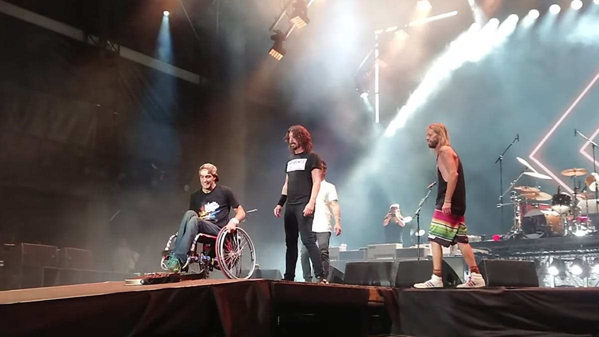 Watch Foo Fighters' Dave Grohl Invite A Fan In A Wheelchair Onstage During Everlong
