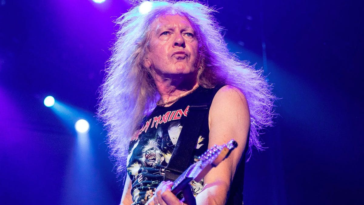 Watch Iron Maiden's Janick Gers Accidentally Hurl His Guitar Into The Crowd